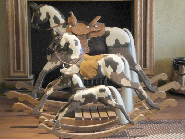 Home decor and decorations: wooden rocking horses.  Comes in 3 sizes.